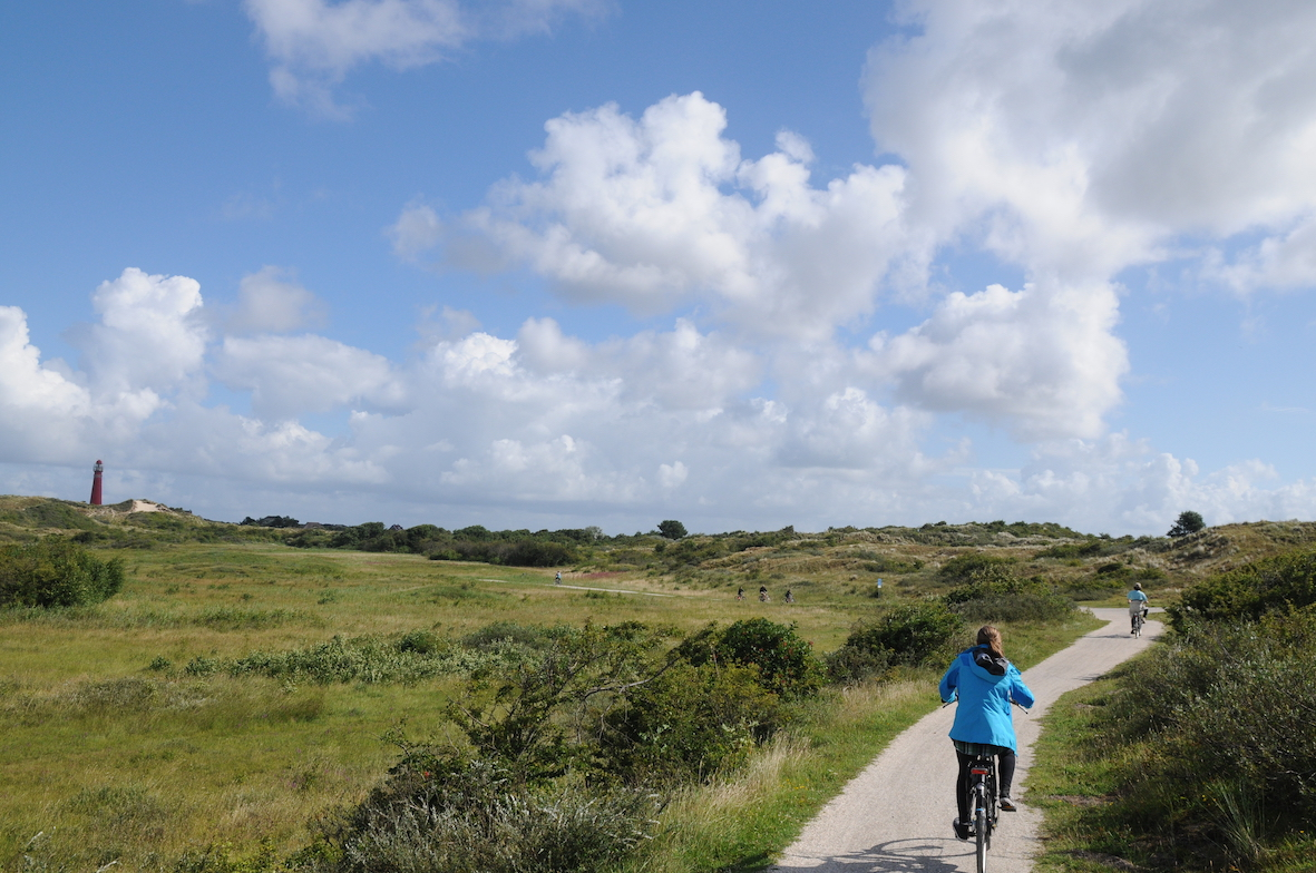 Woman cycling on bike on Schiermonnikoog island in the Netherlands