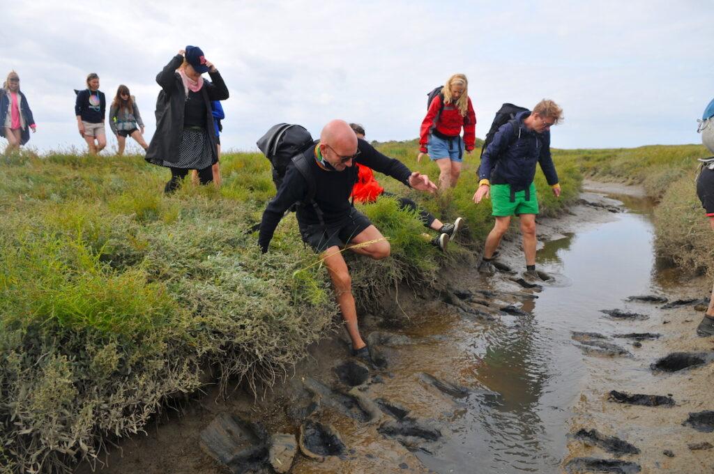 people walking in the mud on Schiermonnikoog
