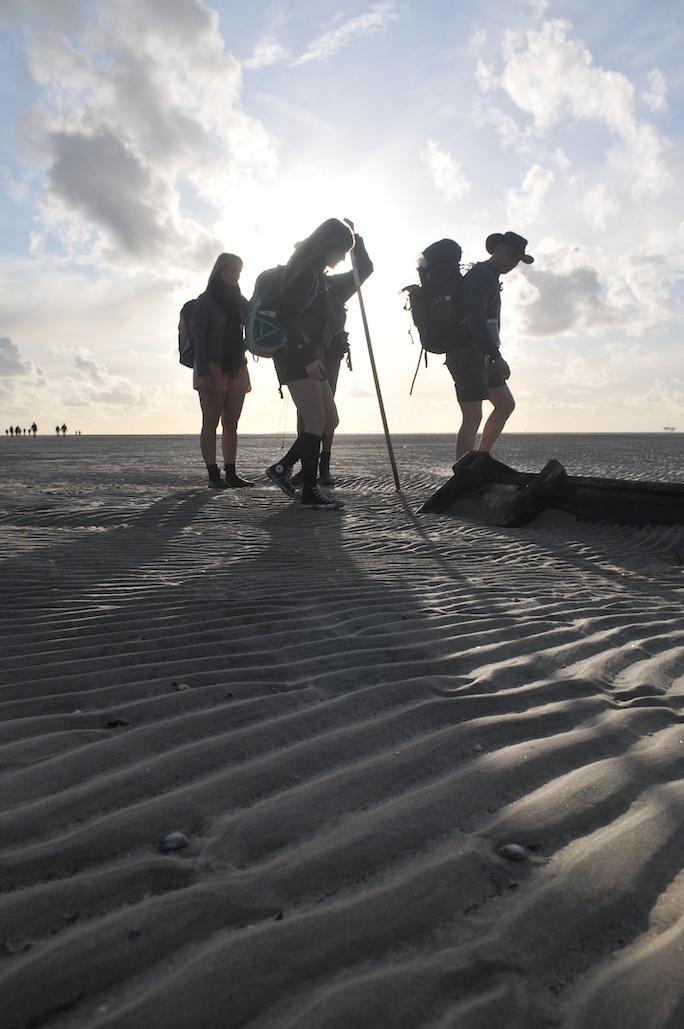 people walking on sand t'rif